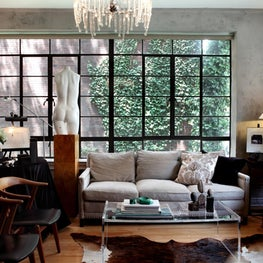 Industrial chic in Gramercy Park / Metal windows, raw cement walls and an eclectic collection of found objects and mid century pieces.