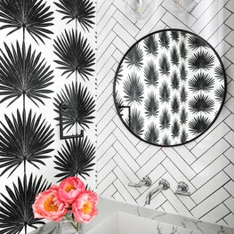 Black and white powder bath with Clay McClaurin Palmetto wallpaper in Jet