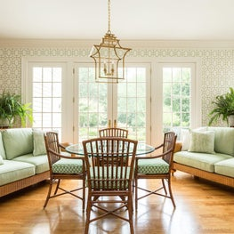 Chinoiserie inspired garden room with distinctive bamboo gilt chandelier and bamboo lattice wallpaper.