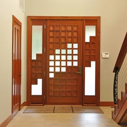 African Mahogany door with a lattice pattern