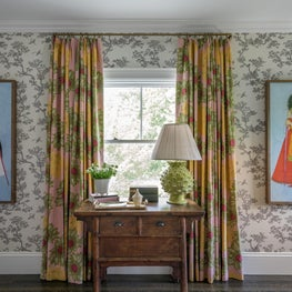 Bright Window with Antique Wood console Table, and Printed Drapery Panels
