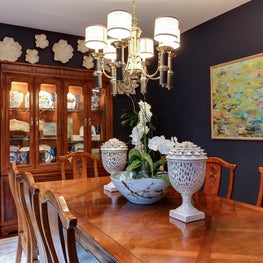 Traditional dining room with flower wall detail and navy walls