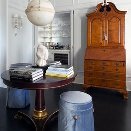 Traditional gallery room with classic armoire