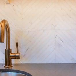 Bronze fixture with designer tile