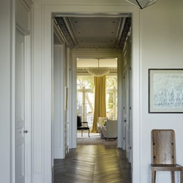 Hallway leading from a Living Room to a Dining and Great Room