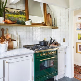 Bohemian French Kitchen with Green Stove and Zellige Backsplash