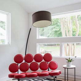 Bright and modern playroom with mod dot love seat