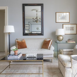A gracious mix and mirror in this soft bedroom add to the glamour