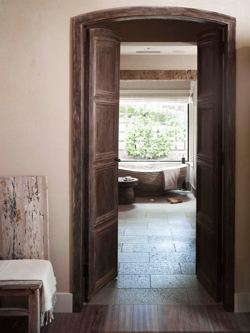 French Antique doors to the Master Bath and a solid travertine bathtub