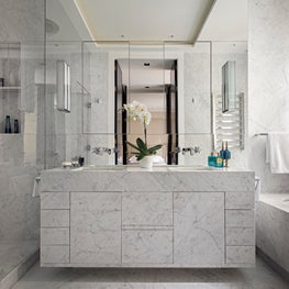 A master bathroom in marble and mirrors