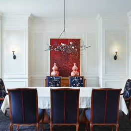 Overlay French panels dress the walls in formal dining room