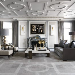 Chicago living room with geometric custom ceiling and oversized rug by Deniot