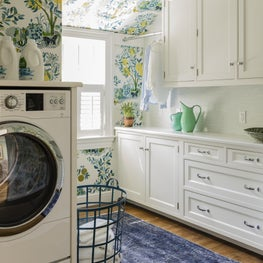 Laundry room with Schumacher wallpaper designed by Robin Gannon Interiors