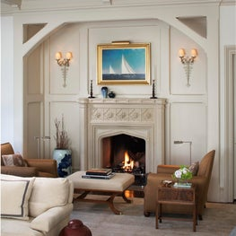 Curl up by the fire, the architectural detailing carries out even around the stone fireplace...