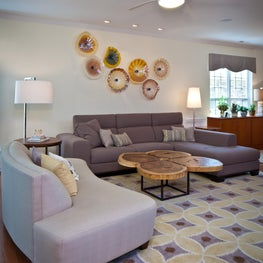 Transitional living with geometric rug, one-of-a-kind table and glass platters