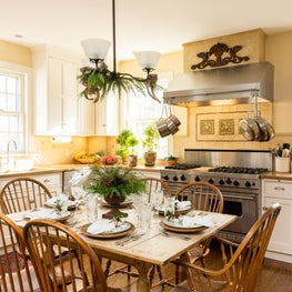 Farmhouse kitchen with classic white Shaker-style cabinets & wood counters