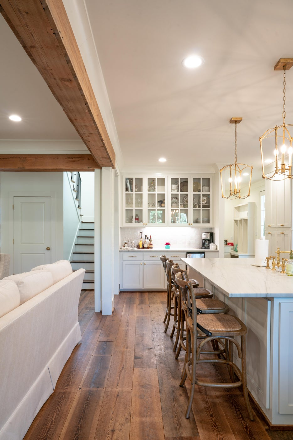 Private Residence. Wide Plank, Saw Kerf Pine Flooring. Reclaimed Pine Beams.