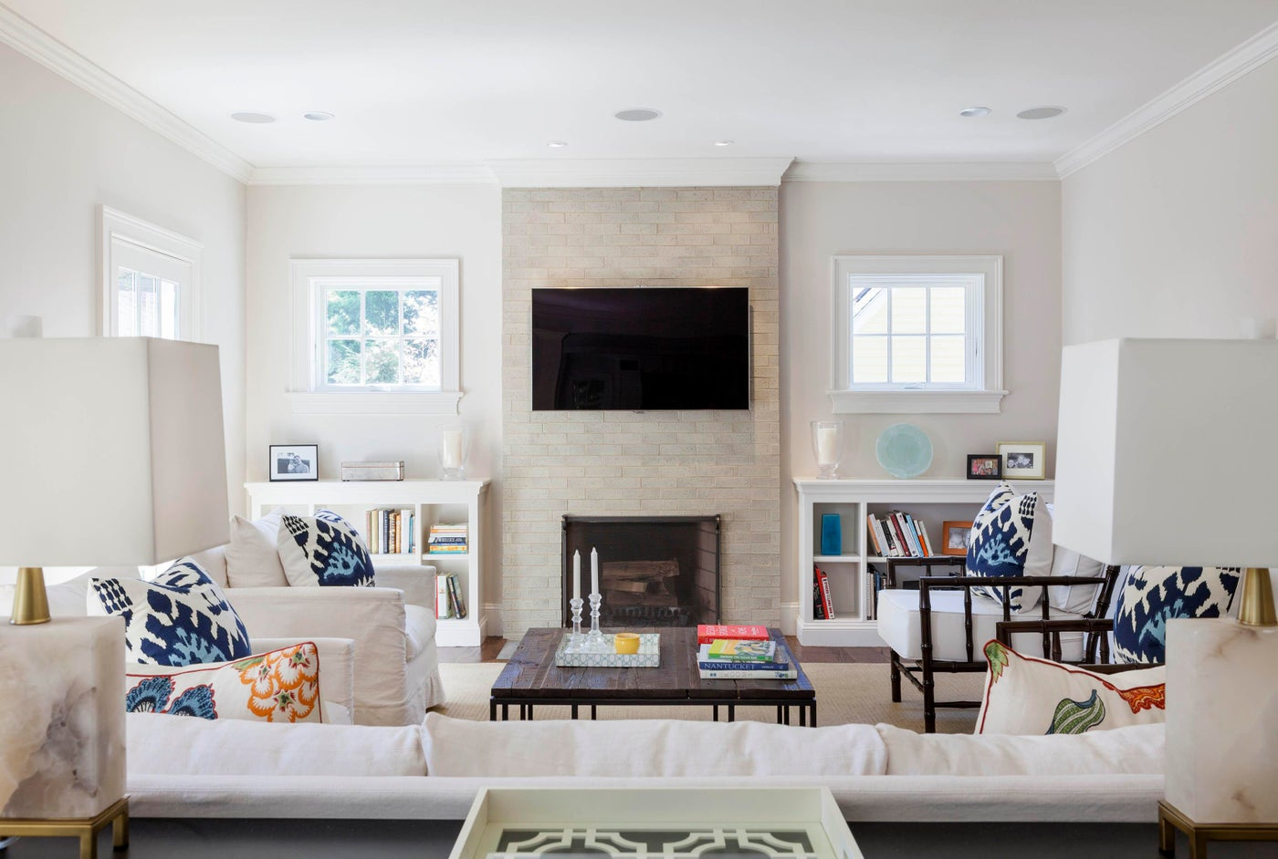 A rustic glazed brick tile makes a statement as it wraps the fireplace wall