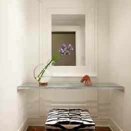Lincoln Park Residence Foyer with a Knoll Barcelona Stool.