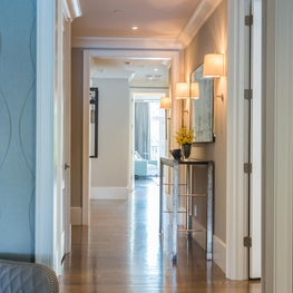 Natural light travels beautifully on the warm hardwoods of this long hallway.