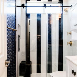 Black and White Striped Walls & Floors in this Glamorous Bathroom