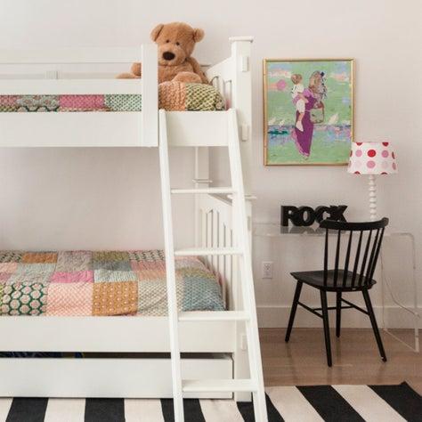 Twin bunk beds in children's bedroom.