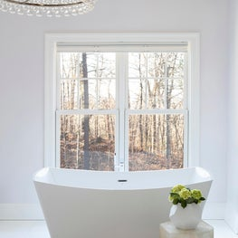 All white bathroom with majestic soaker tub.