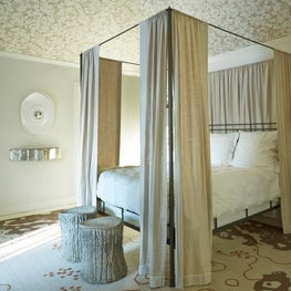 Garden bedroom with organic rug and dogwood canopy