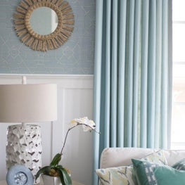 Transitional coastal blue living room with wainscoting