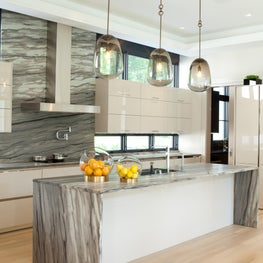 Tenafly modern kitchen with amber lanterns and taupe lacquer cabinets.