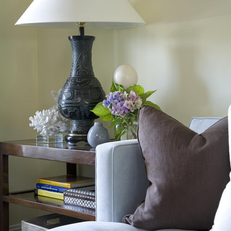 A quiet corner with soft velvet upholstery and an antique lamp from Japan.