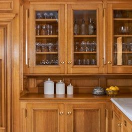 The hardwood millwork in this classic kitchen is period perfect.