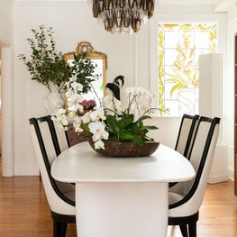Contemporary Dining with classical elements in a monochromatic setting