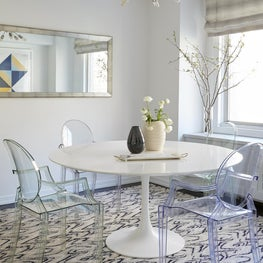 Upper East Side Dining Room with Ghost Chairs, tulip table and patterned rug