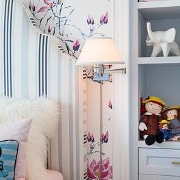 Playful girl's bedroom with custom headboard Osborne & Little wallpaper