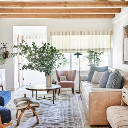 Eclectic Living Room with Leather Sofa, Turkish Rug and Vintage Coffee Table