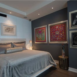 Hollywood Glamour master bedroom that is light and airy with serious detail.