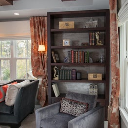 Cozy 'library' corner in the bedroom -- as avid readers, the clients couldn't think of anything more wonderful than to be surrounded by their books