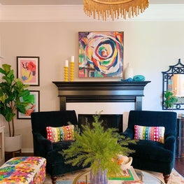 Colorful lounge with art and fireplace