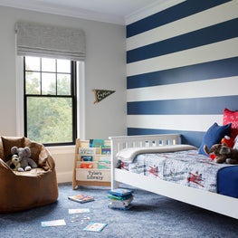 Kid's room with stripe walls