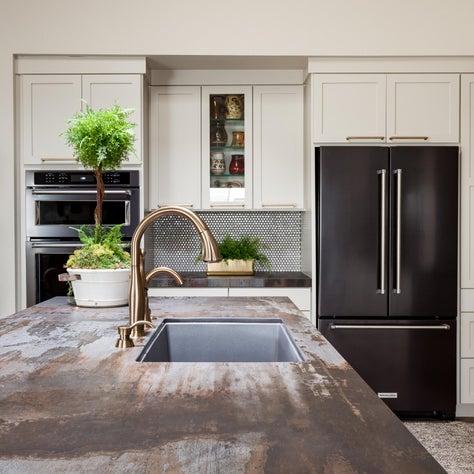 Kitchen island with Trillium Dekton counters and off white cabinetry
