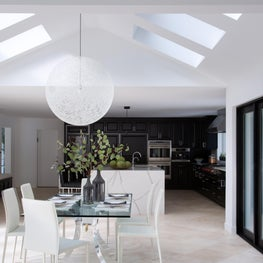 Contemporary Gold Coast dining room, large white sphere pendant, vaulted ceiling