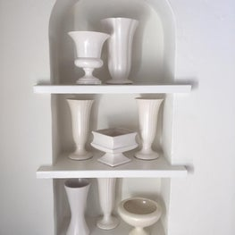 Living room niche with a collection of vintage white American pottery