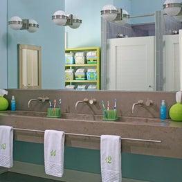 Lake Michigan Dorm Bath Concrete,Trough Sink, Shower Stalls, Numbered Towels