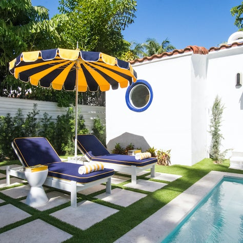 Mediterranean inspired backyard and pool area