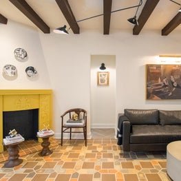 Vintage fireplace was restored and accented in bright bold color.