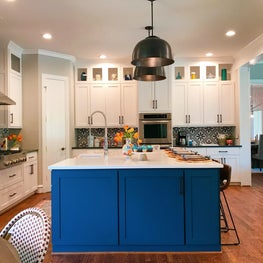 Kitchen with blue cabinets and pattern tile