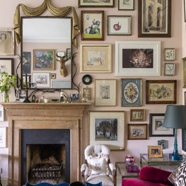 Living room fireplace with gallery wall