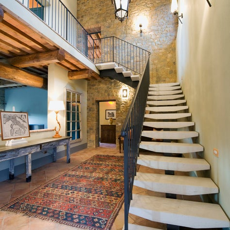 Contemporary staircase in a traditional farmhouse - magical mix