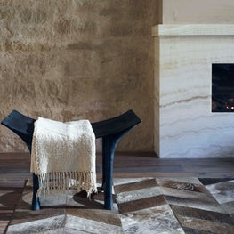 This formations bench is a sculptural anchor in front of the onyx fireplace.